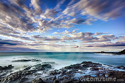 Cloudscape over rocky coast