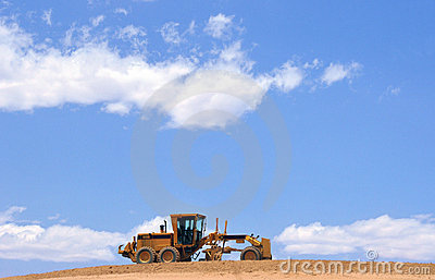 Cloudscape and road grader