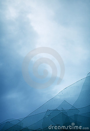 Cloudy blue sky through broken window