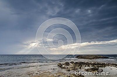 Cloudy sky with coast, Is Aruttas, Sardinia