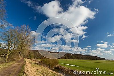 Cloudy sky in dutch landscape.