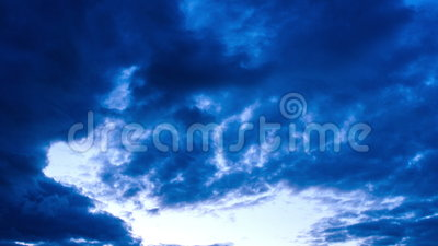 Cloudy sky in the evening. Cloudy sky in the late evening getting very dark stock footage