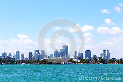 Cloudy sky over the water and Miami city, Florida.