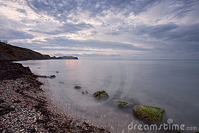 Cloudy sunrise on Black sea rocky shore