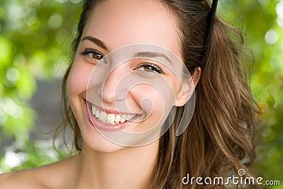 Clouseup portrait of a friendly brunette.