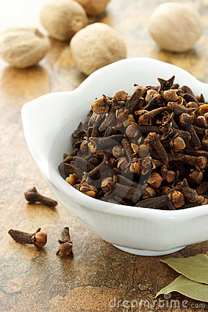Cloves with nutmegs and bay leaves
