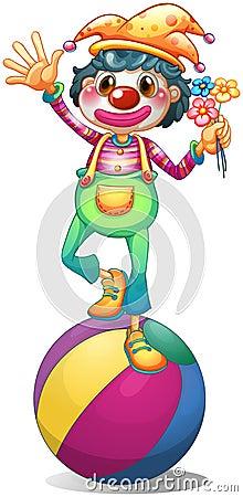 A clown balancing above a ball