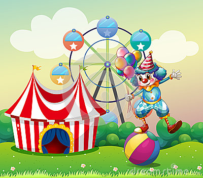 A clown balancing above an inflatable ball at the carnival