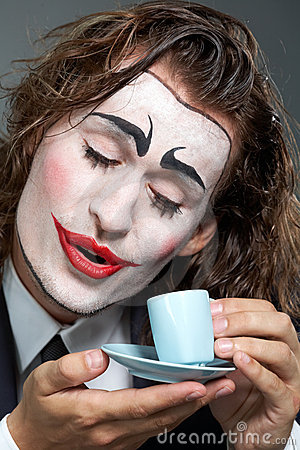 Clown with coffee