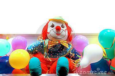 Clown between coloured balloons