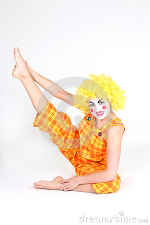 Clown in colourful costume doing gymnastic