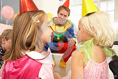 Clown entertaining children