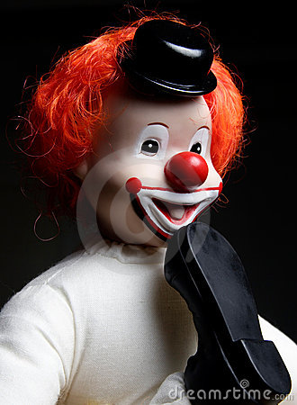 Clown with foot in his mouth