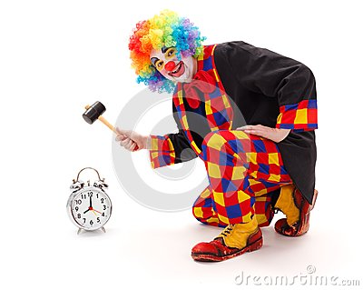 Clown hitting alarm clock with hammer