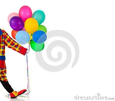 A Clown holding ballons