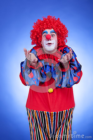 Clown men in red costume on blue background
