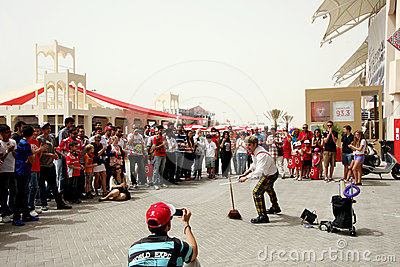 A clown performs at F1 village, 20 April 2012 Editorial Stock Image