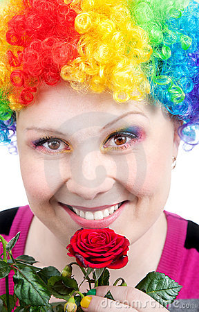 Clown with rainbow make up with rose