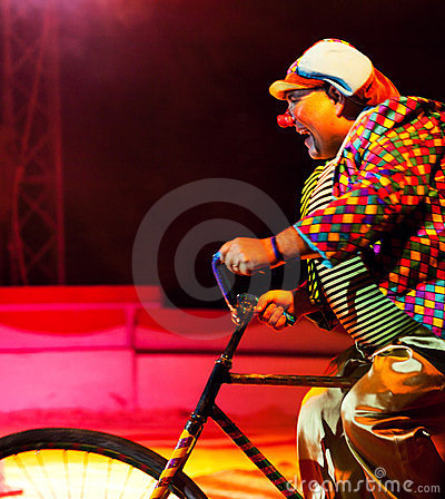 Clown riding bicycle Editorial Stock Photo