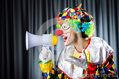 Clown in studio with loudspeaker