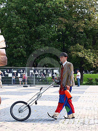 Clown with a unicycle, Lublin, Poland Editorial Photo