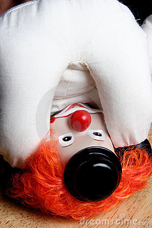 Clown upside down looking at own ass