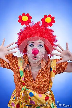 Clown woman on blue background studio shooting
