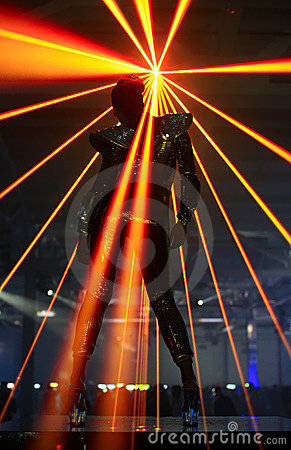 Club dancer against laser rays