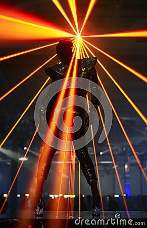 Club dancer against laser rays
