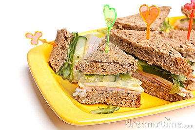 Club sandwiches with ham and cheese,