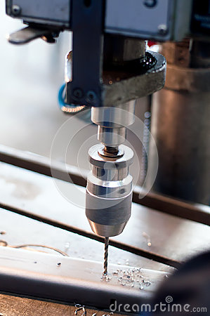 CNC industrial machine making symmetrical holes
