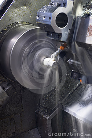 CNC lathe running with coolant