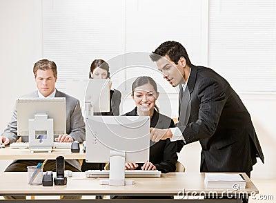 Co-worker listening to supervisor explain problem
