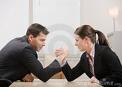 Co-workers arm wrestling for dominance