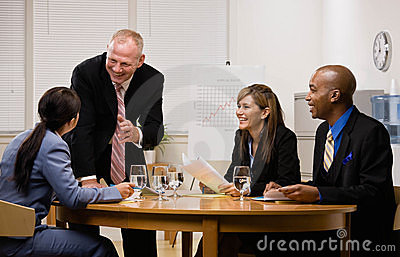 Co-workers having meeting in conference room