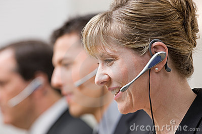 Co-workers in headsets working in call center