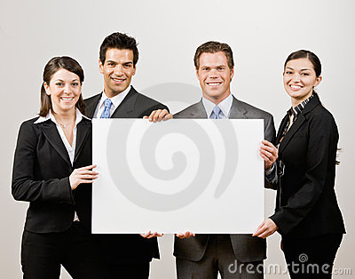Co-workers holding blank paper