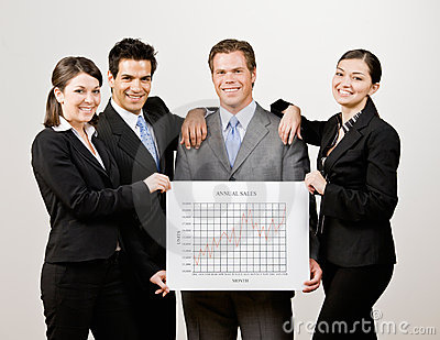 Co-workers holding financial line graph