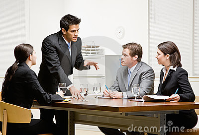 Co-workers listening to supervisor