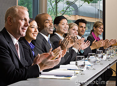 Co-workers meeting at table in conference room