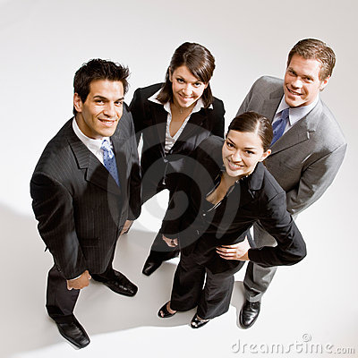 Co-workers standing in group