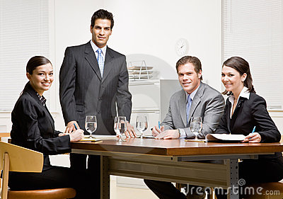 Co-workers and supervisor in conference room