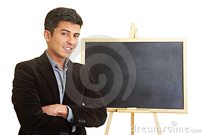 Coach in front of chalkboard