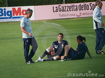 The coach of the Italia soccer team and two player