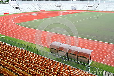 Coach and reserve benches with yellow seats
