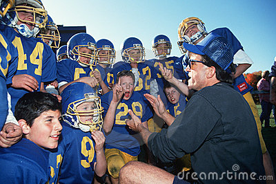 Coach with youth football team Editorial Photography