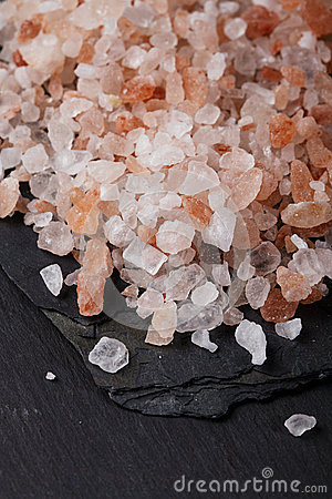 Coarse pink himalayan, sea salt on black slate
