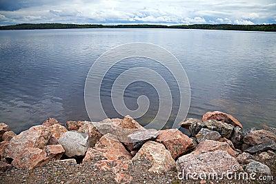 Coast of lake with granite stones
