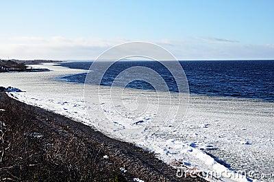 Coast line with ice belt