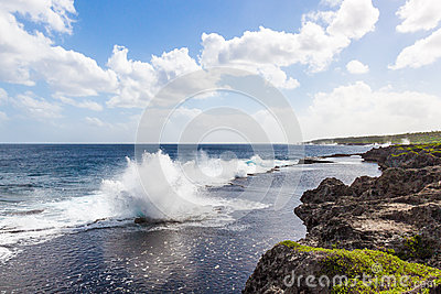 Coast of Pacific ocean with blowholes